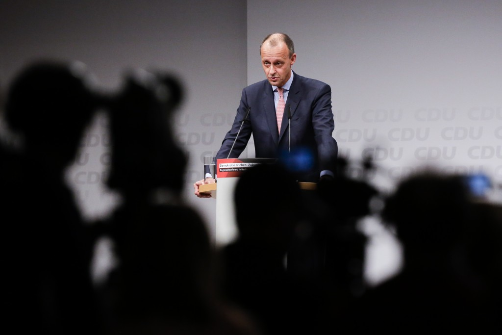 FILE - In this Friday, Nov. 30, 2018 file photo Friedrich Merz, former German Christian Democratic Union party faction leader, speaks during a CDU reg
