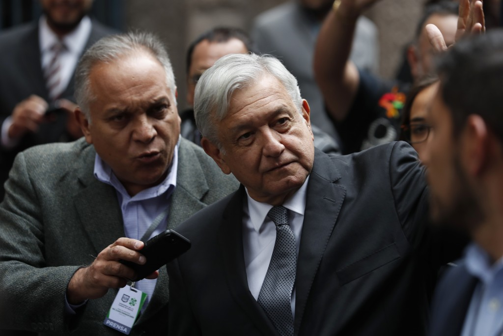 Mexico's President Andres Manuel Lopez Obrador waves as he arrives for the swearing-in ceremony for Mayor-elect Claudia Sheinbaum, in Mexico City, Wed