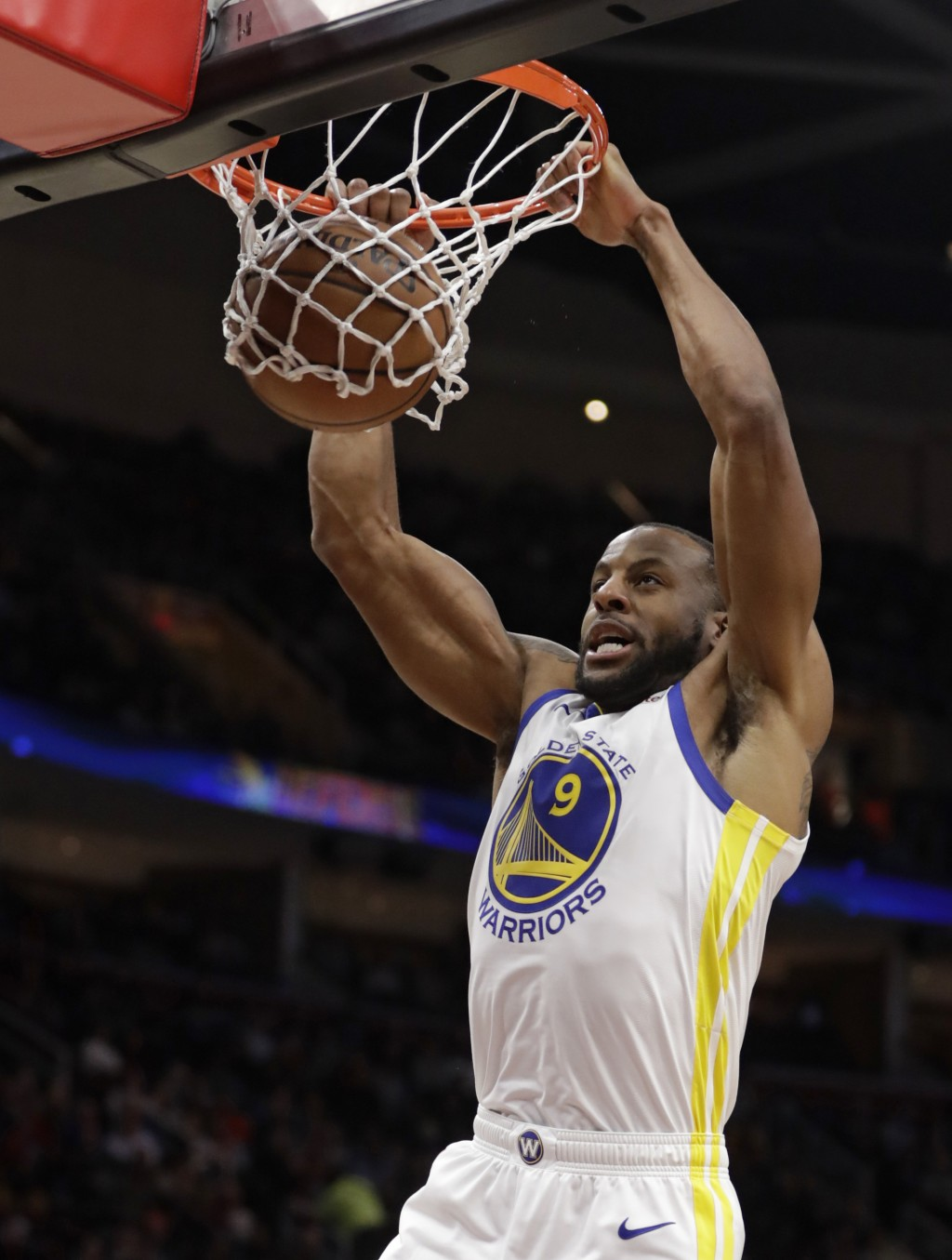 Golden State Warriors' Andre Iguodala dunks the ball against the Cleveland Cavaliers in the second half of an NBA basketball game, Wednesday, Dec. 5,