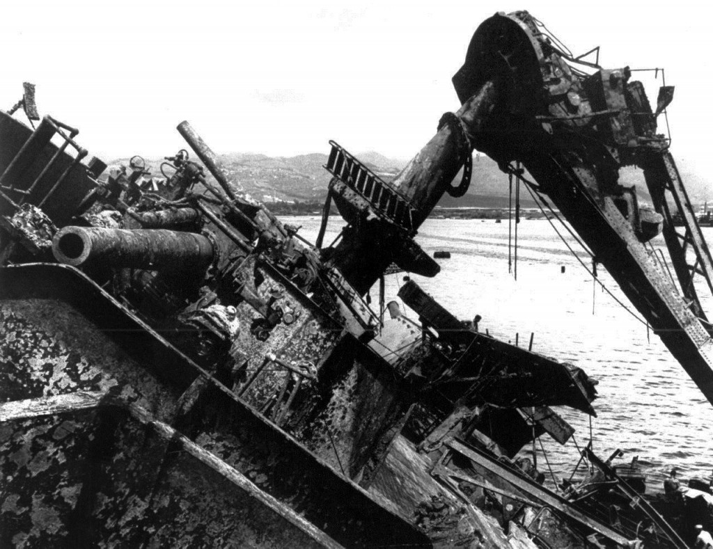 FILE - In this May 24, 1943 file photo, the capsized battleship USS Oklahoma is lifted out of the water at Pearl Harbor in Honolulu, Hawaii. More than