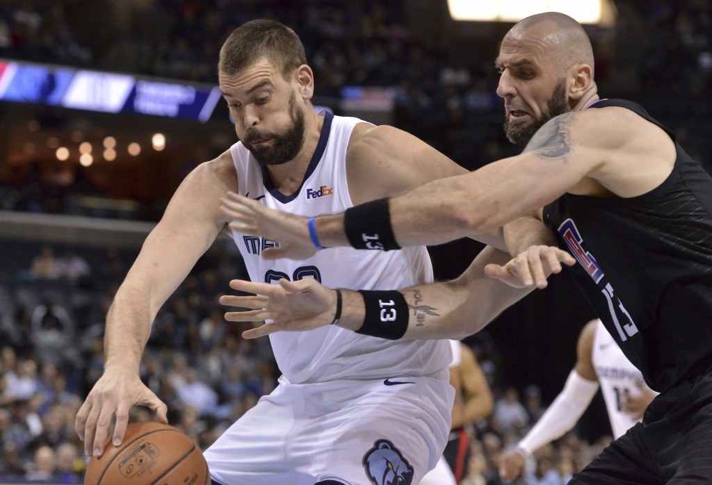 Memphis Grizzlies center Marc Gasol, left, drives against Los Angeles Clippers center Marcin Gortat in the first half of an NBA basketball game Wednes