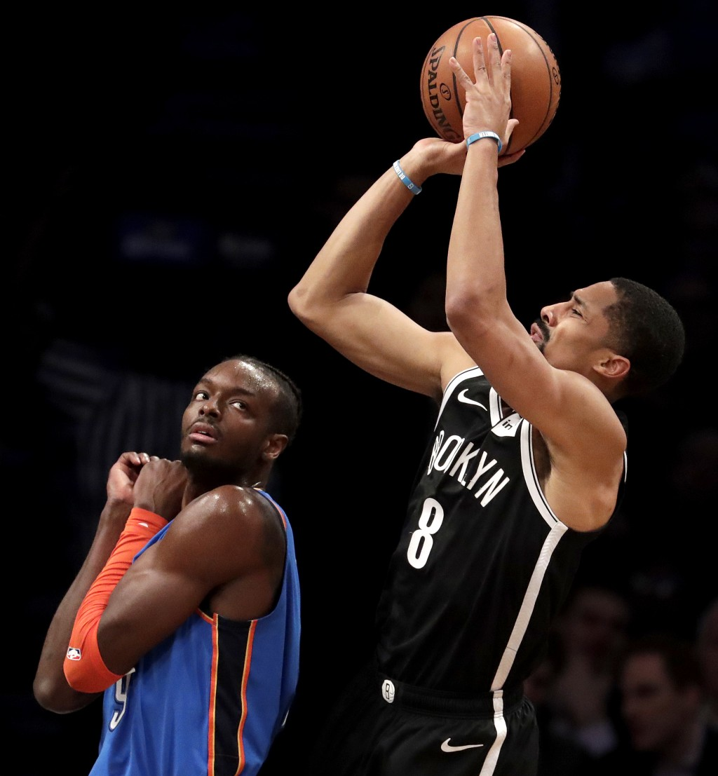 Brooklyn Nets guard Spencer Dinwiddie, right, goes up for a shot against Oklahoma City Thunder forward Jerami Grant during the first half of an NBA ba