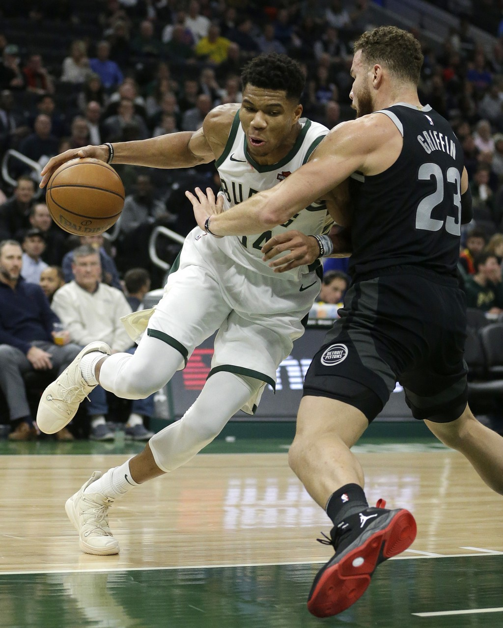 Milwaukee Bucks' Giannis Antetokounmpo, left, drives against Detroit Pistons' Blake Griffin during the second half of an NBA basketball game Wednesday