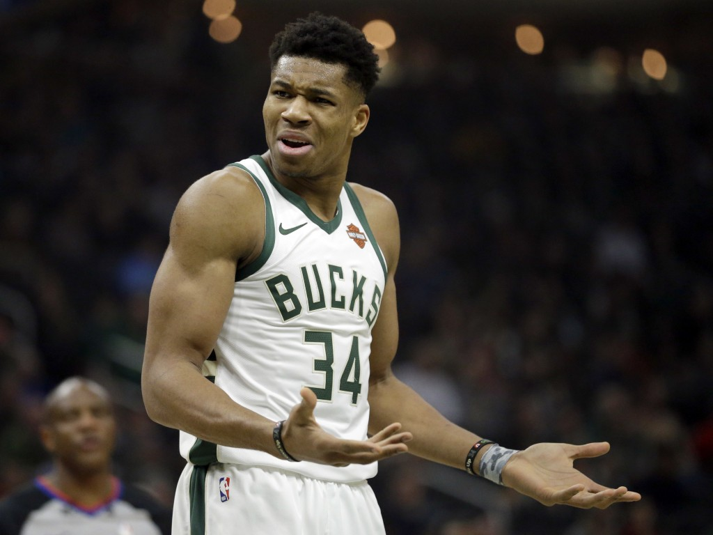 Milwaukee Bucks' Giannis Antetokounmpo reacts to a call during the first half of an NBA basketball game against the Detroit Pistons Wednesday, Dec. 5,