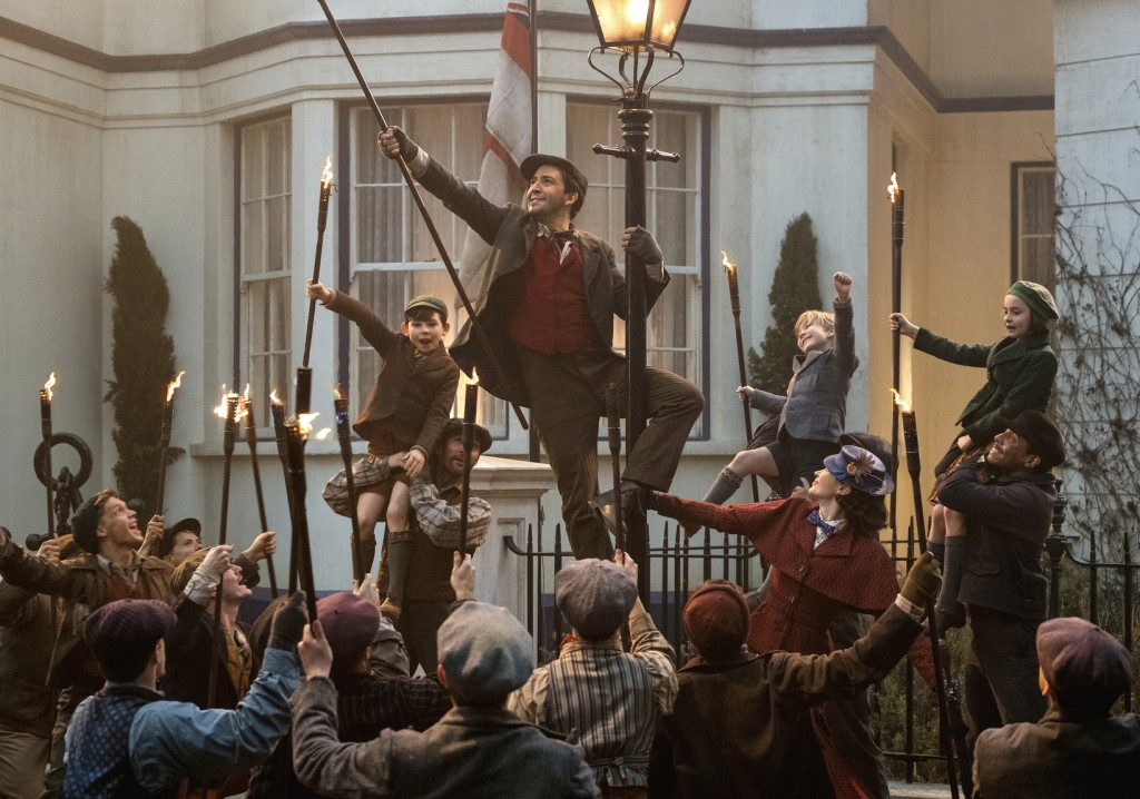 "This image released by Disney shows Lin-Manuel Miranda, center, in ""Mary Poppins Returns.""  On Thursday, Dec. 6, 2018, Miranda was nominated for a Gol"