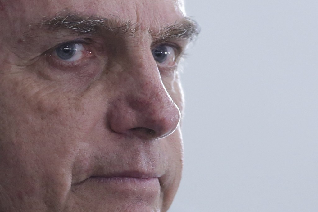 FILE - In this Dec. 5, 2018 file photo, Brazil's President-elect Jair Bolsonaro listens to a question during a press interview, in Brasilia, Brazil. A...