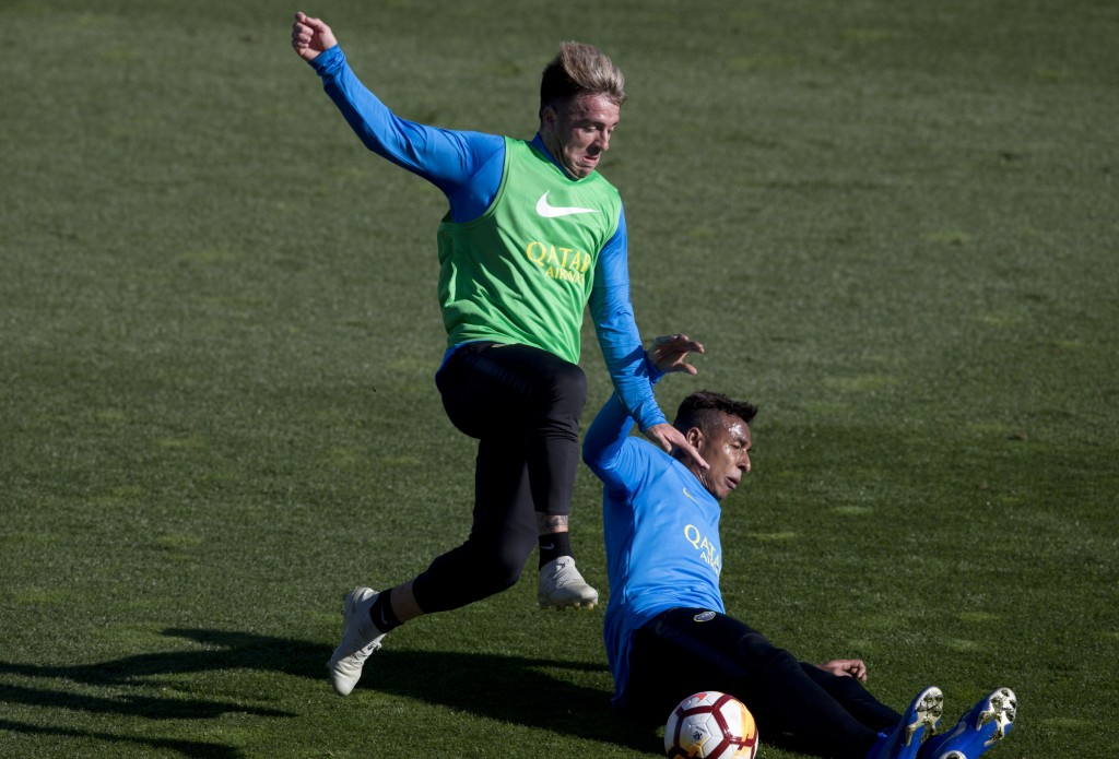 Boca Junior's Julio Buffarini, left and Sebastian Villa challenge for the ball during a training session in Madrid, Spain, Thursday, Dec. 6, 2018. The