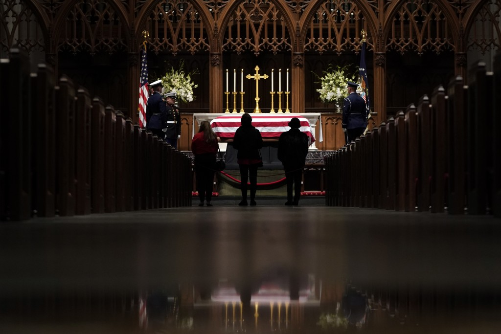 People pay their respects as former President George H.W. Bush lies in repose at St. Martin's Episcopal Church Wednesday, Dec. 5, 2018, in Houston. (A