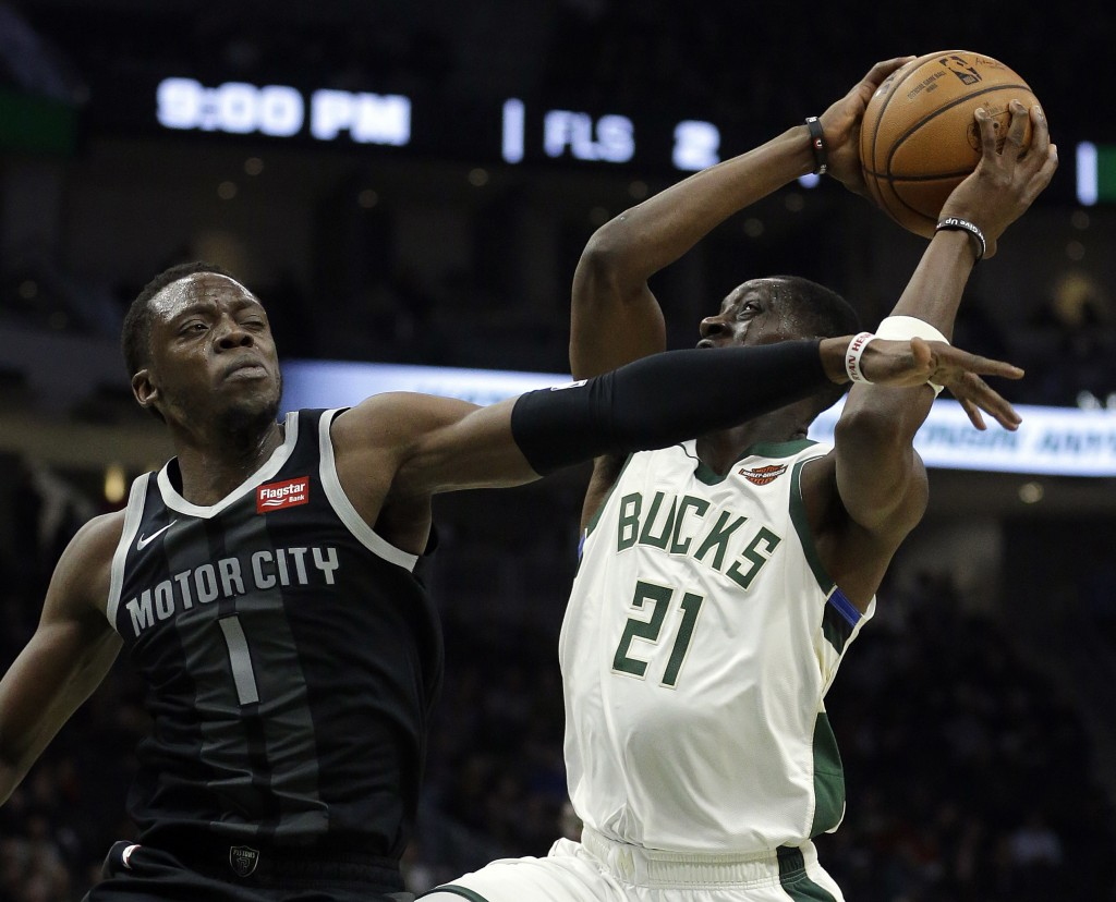 Milwaukee Bucks' Tony Snell (21) is fouled by Detroit Pistons' Reggie Jackson (1) during the second half of an NBA basketball game Wednesday, Dec. 5,
