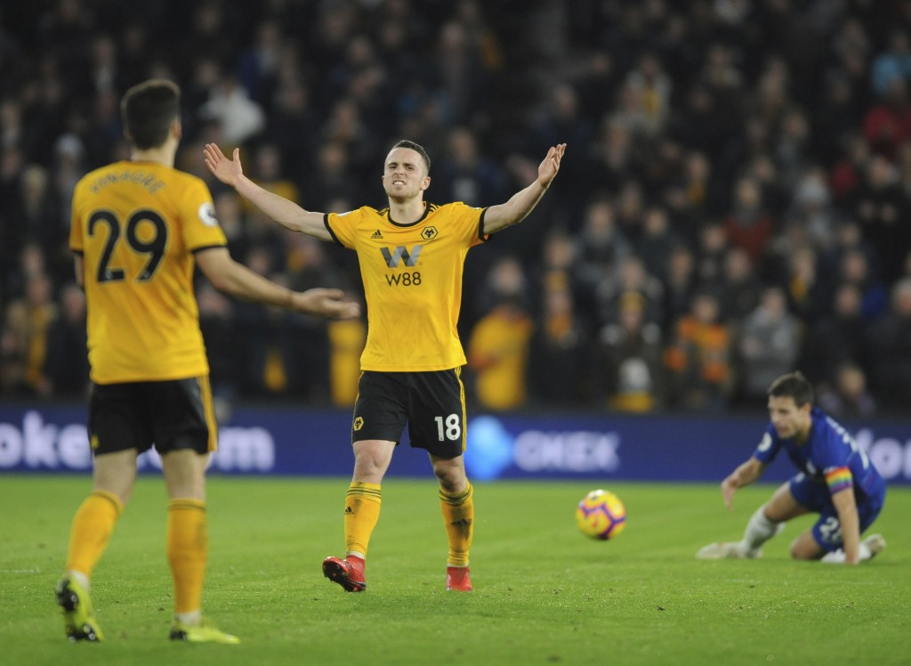 Wolverhampton's Diogo Jota, centre, reacts during the English Premier League soccer match between Wolverhampton Wanderers and Chelsea at the Molineux