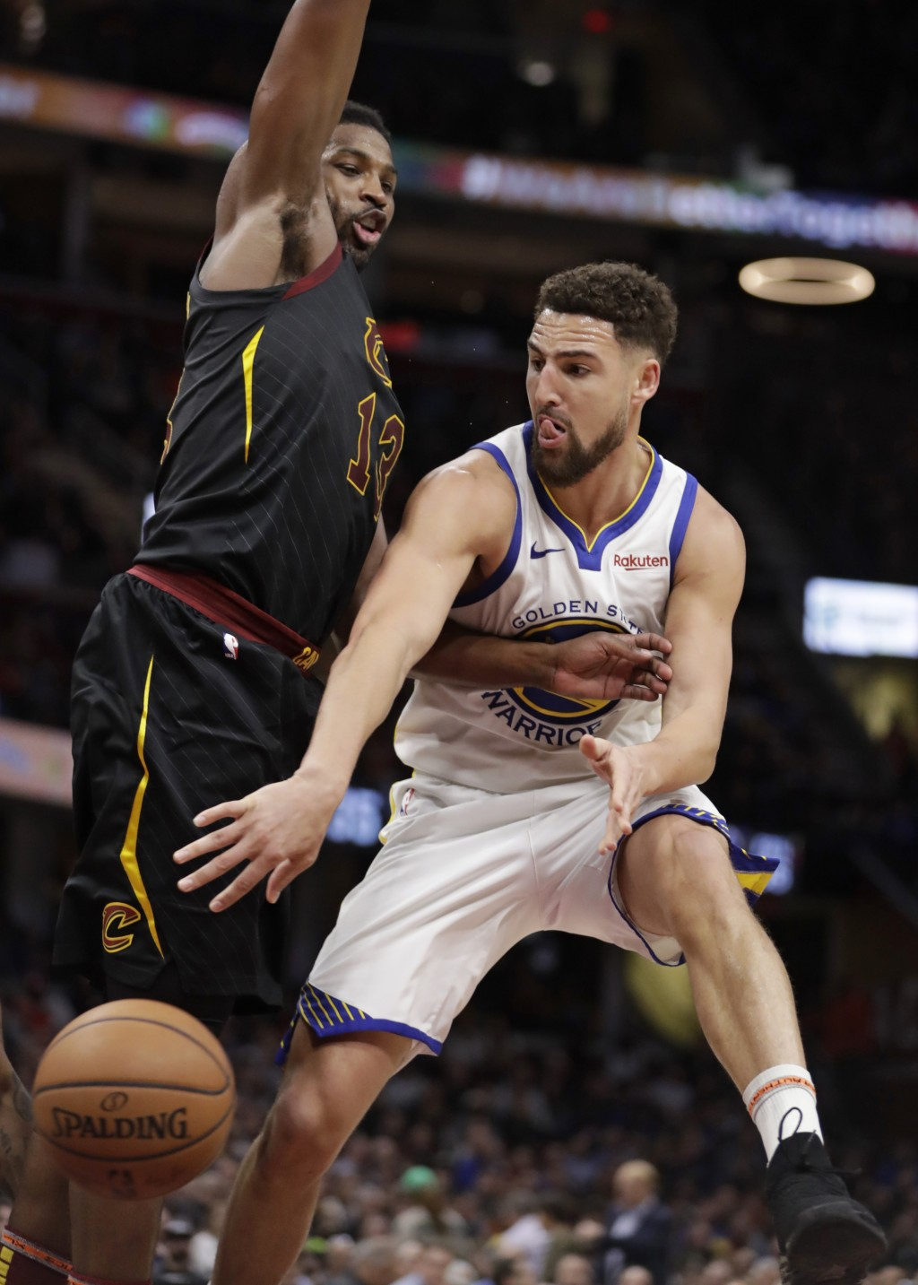 Golden State Warriors' Klay Thompson, right, passes against Cleveland Cavaliers' Tristan Thompson in the second half of an NBA basketball game, Wednes