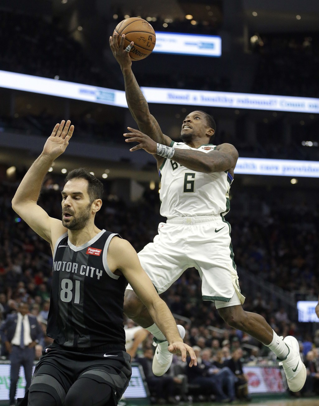 Milwaukee Bucks' Eric Bledsoe (6) goes up for a shot in front of Detroit Pistons' Jose Calderon during the second half of an NBA basketball game Wedne