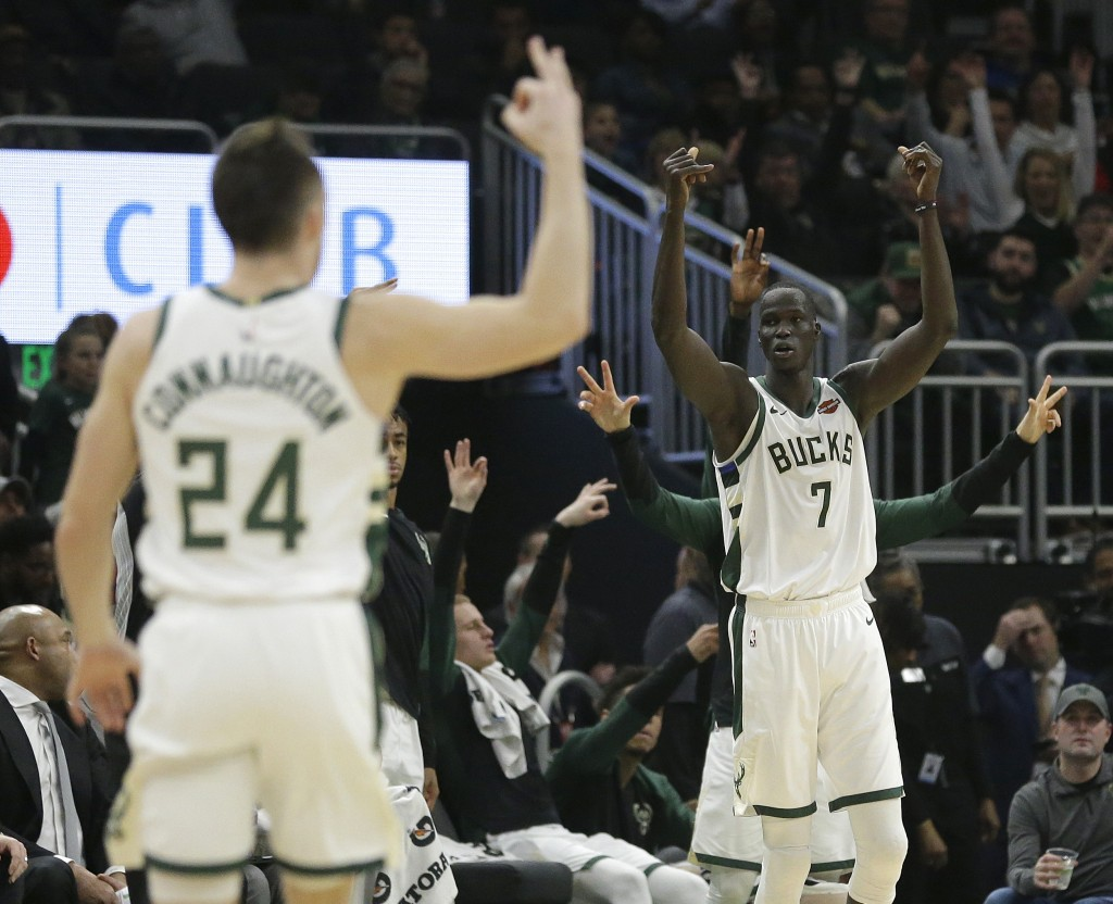 Milwaukee Bucks' Thon Maker (7) reacts after making a three-pointer during the first half of an NBA basketball game against the Detroit Pistons Wednes