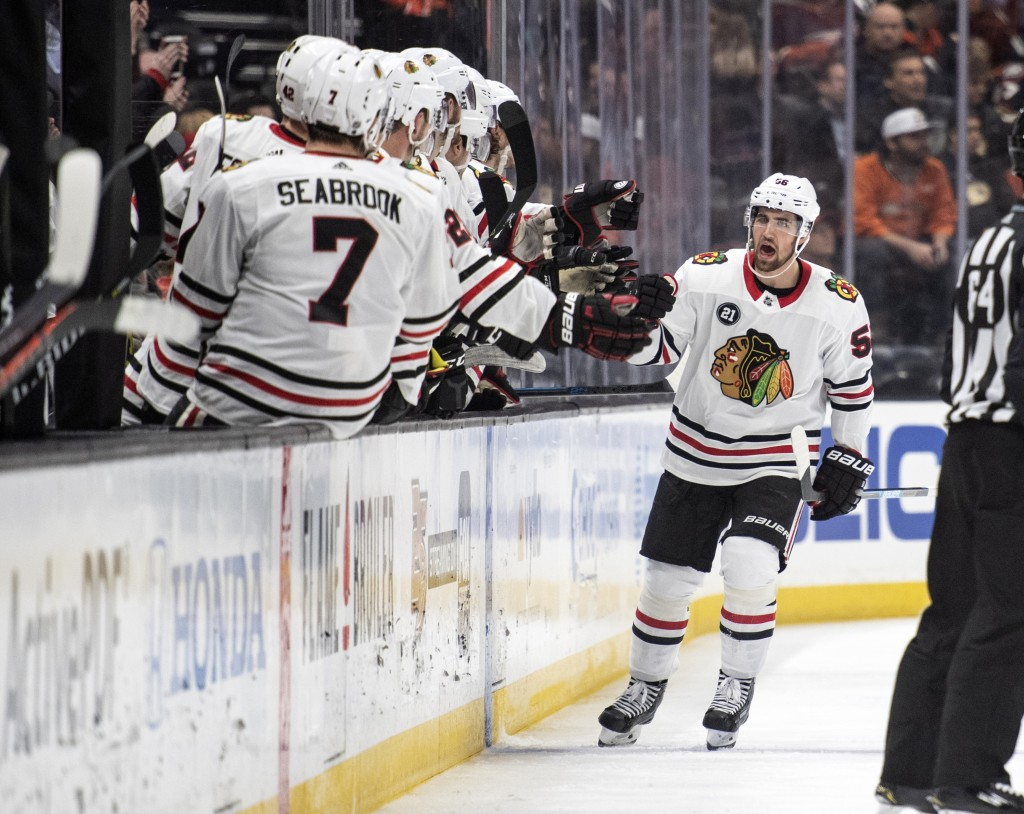 Chicago Blackhawks defenseman Erik Gustafsson celebrates his goal with the bench in the second period of an NHL hockey game against the Anaheim Ducks