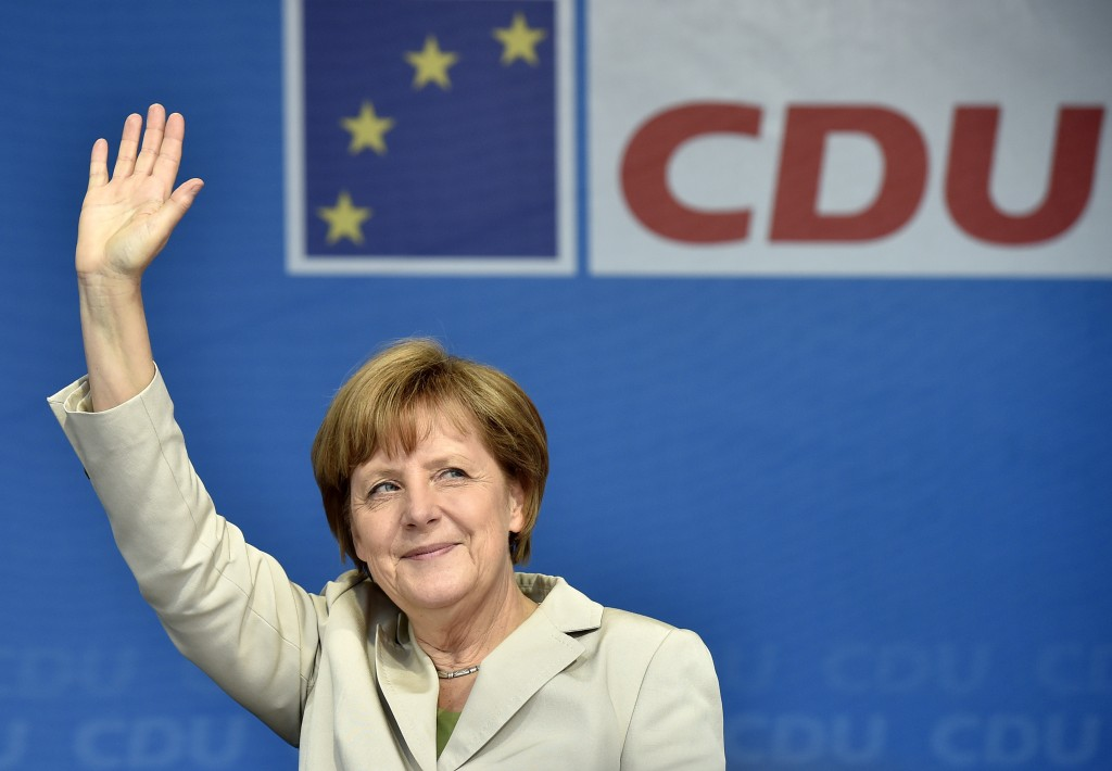 FILE - In this Tuesday, Dec. 4, 2018 file photo German chancellor Angela Merkel waves to supporters at the final election party of her Christian Democ