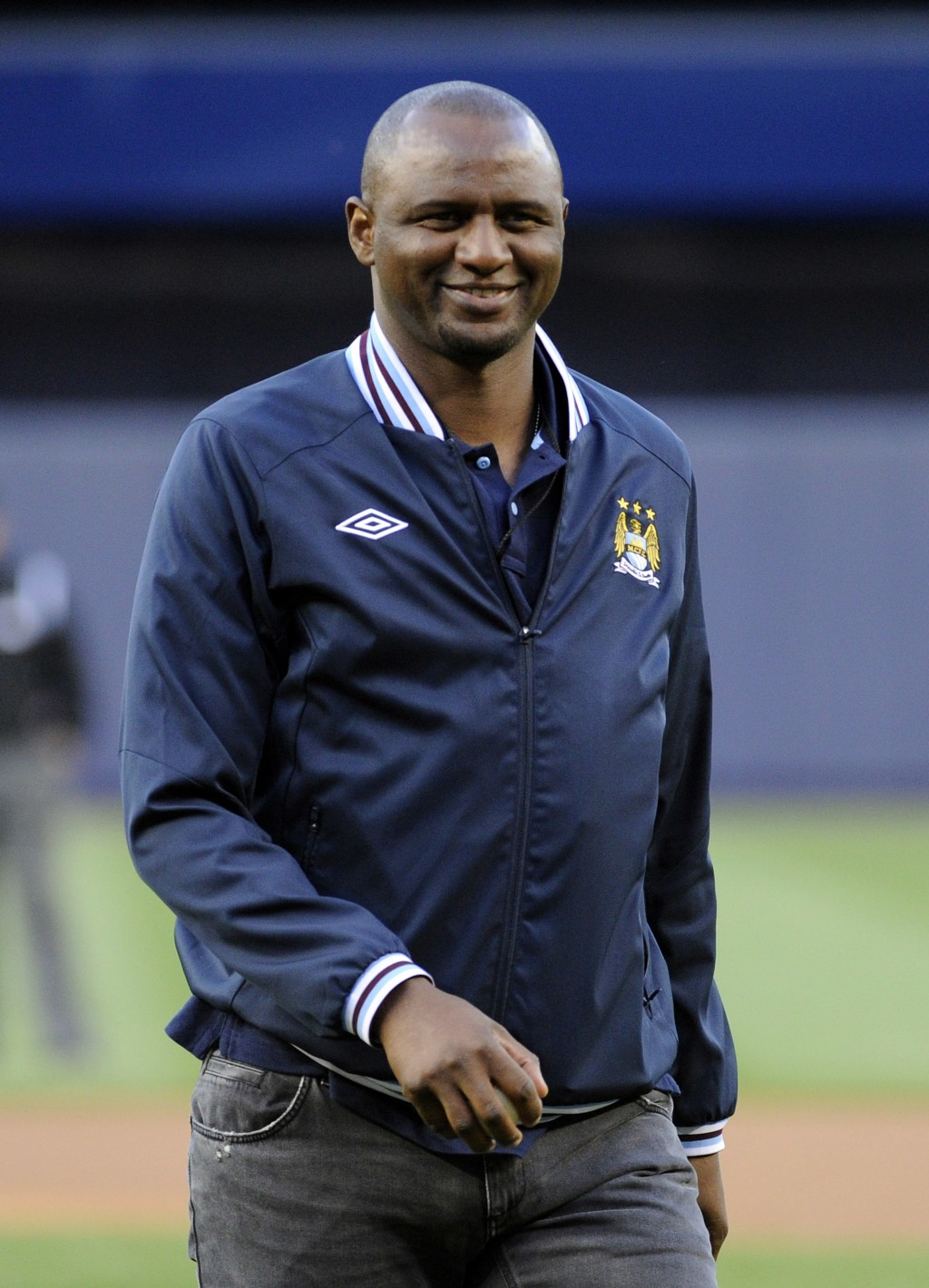 FILE - In this file photo dated Friday, May 17, 2013, Patrick Vieira of Manchester City reacts after throwing out the first pitch before the New York