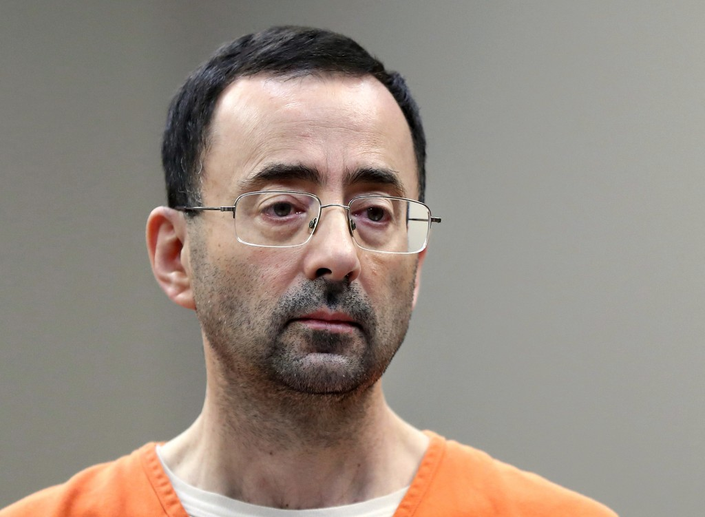 FILE - In this Nov. 22, 2017, file photo, Larry Nassar, a sports doctor accused of molesting girls while working for USA Gymnastics and Michigan State