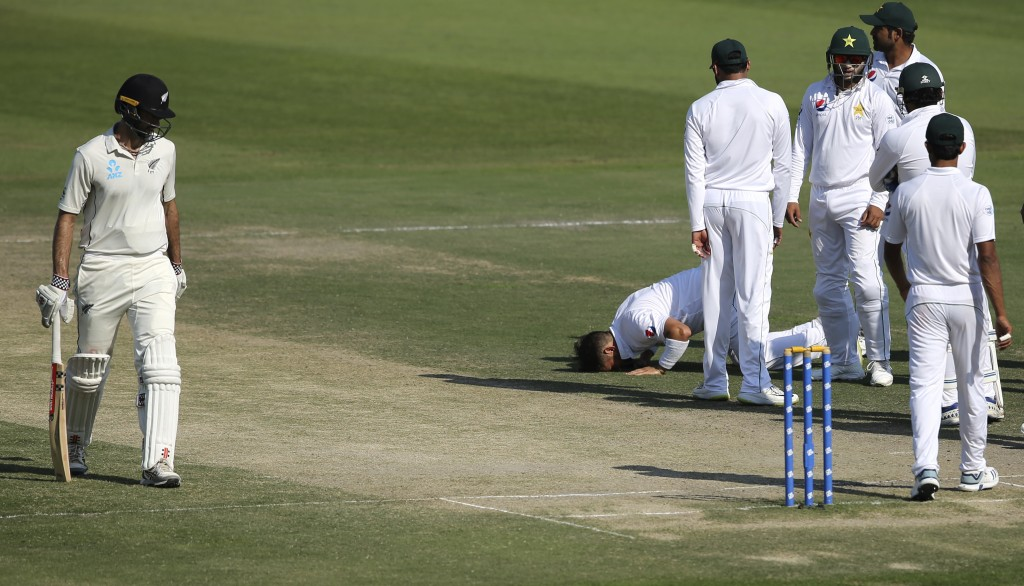Pakistan's Yasir Shah prays the dismissal of New Zealand's Will Sumerville in thei cricket test match in Abu Dhabi, United Arab Emirates, Thursday, De