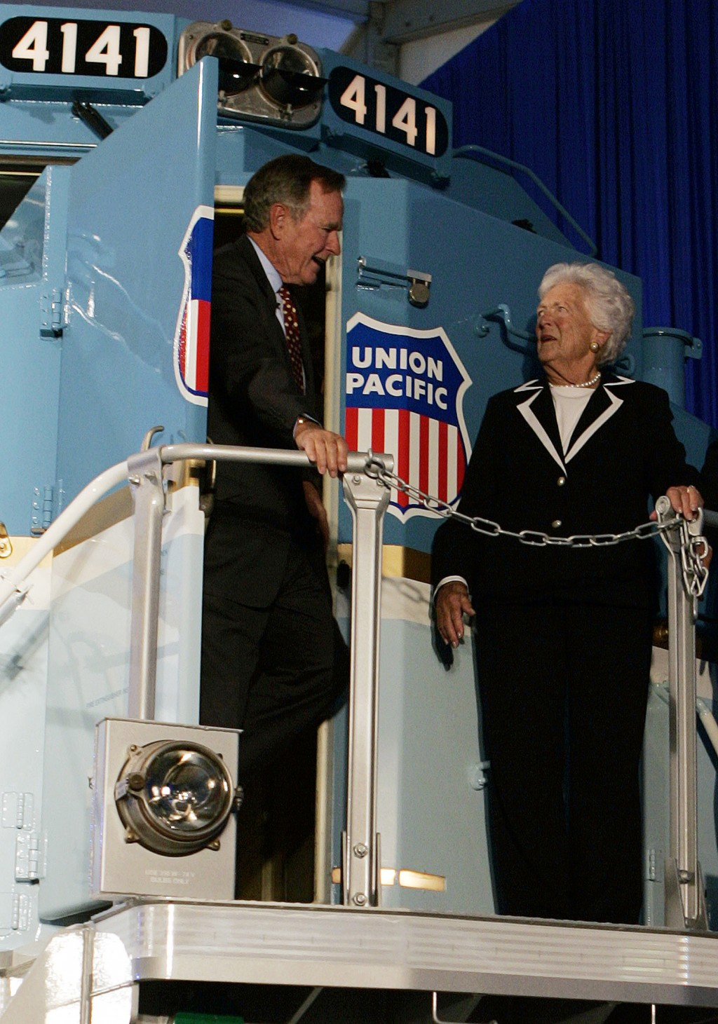 FILE - In this Oct. 18, 2005, file photo, former President George H.W. Bush and his wife, Barbara, tour a new locomotive numbered 4141 in honor of the