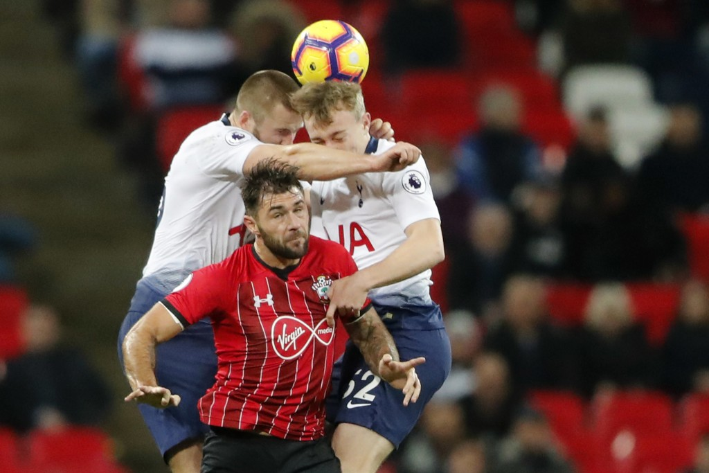 Tottenham's Eric Dier, left, Tottenham's Oliver Skipp, right, and Southampton's Charlie Austin challenge for the ball during the English Premier Leagu