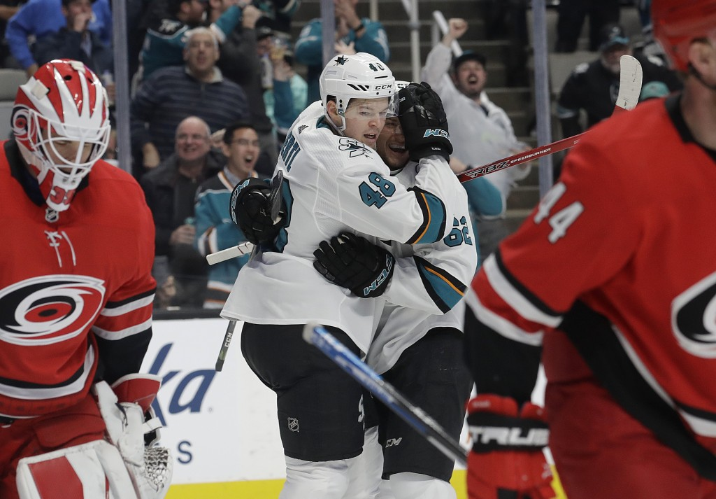San Jose Sharks center Tomas Hertl (48), from the Czech Republic, is congratulated by right wing Kevin Labanc (62) after scoring a goal against the Ca
