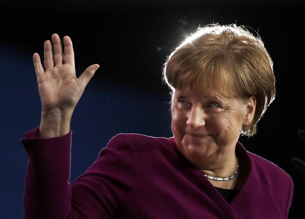 FILE - In this Monday, Feb. 26, 2018 file photo German Chancellor and party chairwoman Angela Merkel waves during the party convention of the Christia