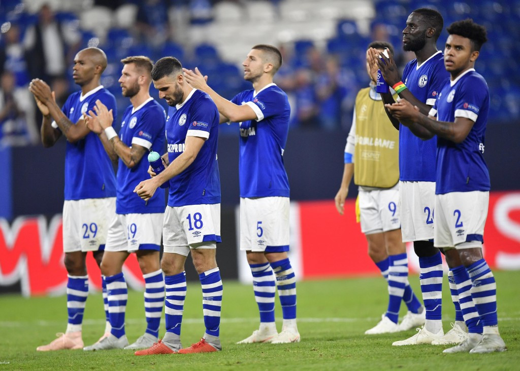 In this picture taken Nov.24, 2018 Schalke players acknowledge the fans after the Champions League group D soccer match between FC Schalke 04 and FC P