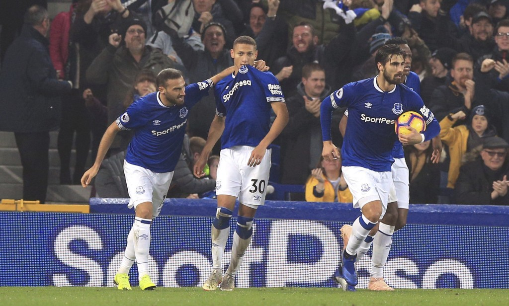 Everton's Richarlison, centre, celebrates scoring his side's first goal of the game against Newcastle United during their English Premier League socce