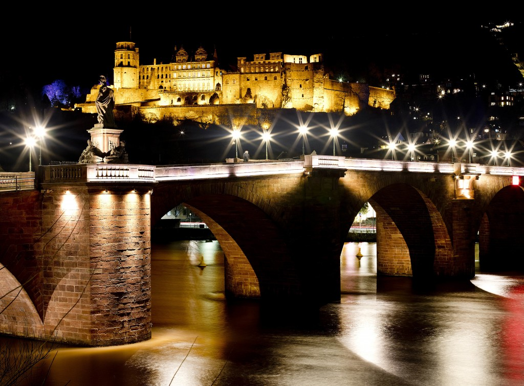 In this Tuesday, Dec. 4, 2018 photo the Old Bridge and the castle in background are seen on the way to the traditional Christmas market in Heidelberg,