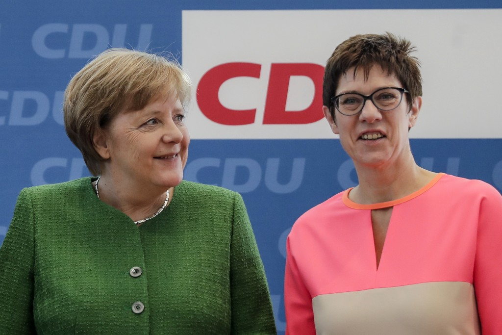 FILE - In this Monday, Feb. 19, 2018 file photo German Chancellor Angela Merkel, left, and the governor of German Saarland state and designated Christ