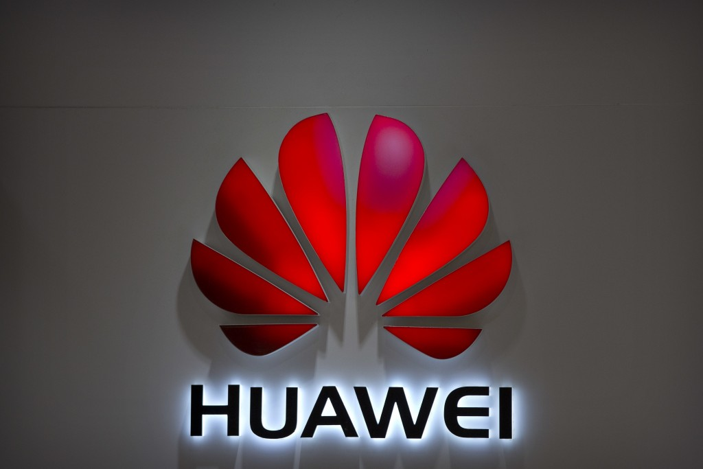 FILE - In this July 4, 2018, file photo, the Huawei logo is seen at a Huawei store at a shopping mall in Beijing. Canadian authorities said Wednesday,