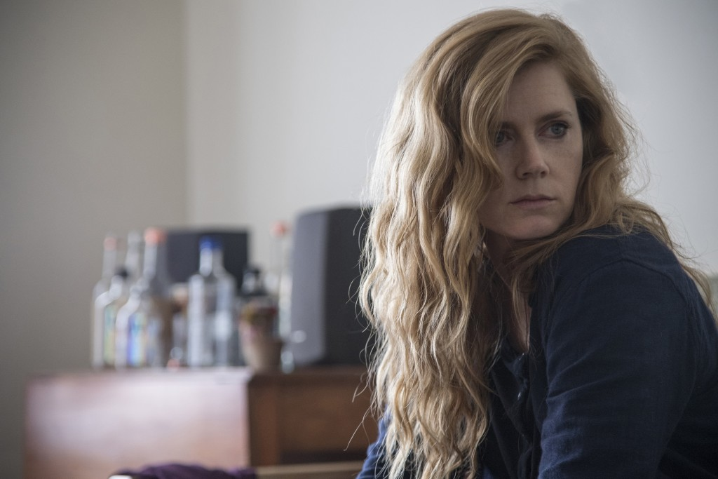 "This image released by HBO shows Amy Adams in a scene from ""Sharp Objects."" On Thursday, Dec. 6, 2018, the program was nominated for a Golden Globe aw"