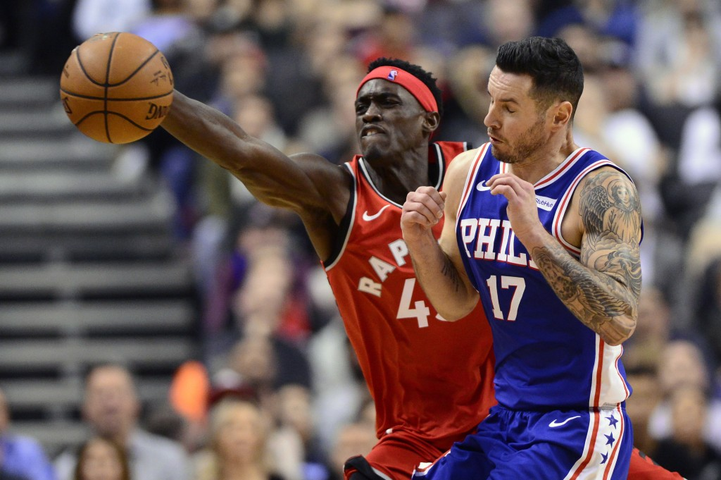 Toronto Raptors forward Pascal Siakam (43) and Philadelphia 76ers guard JJ Redick (17) battle for a loose ball during the second half of an NBA basket
