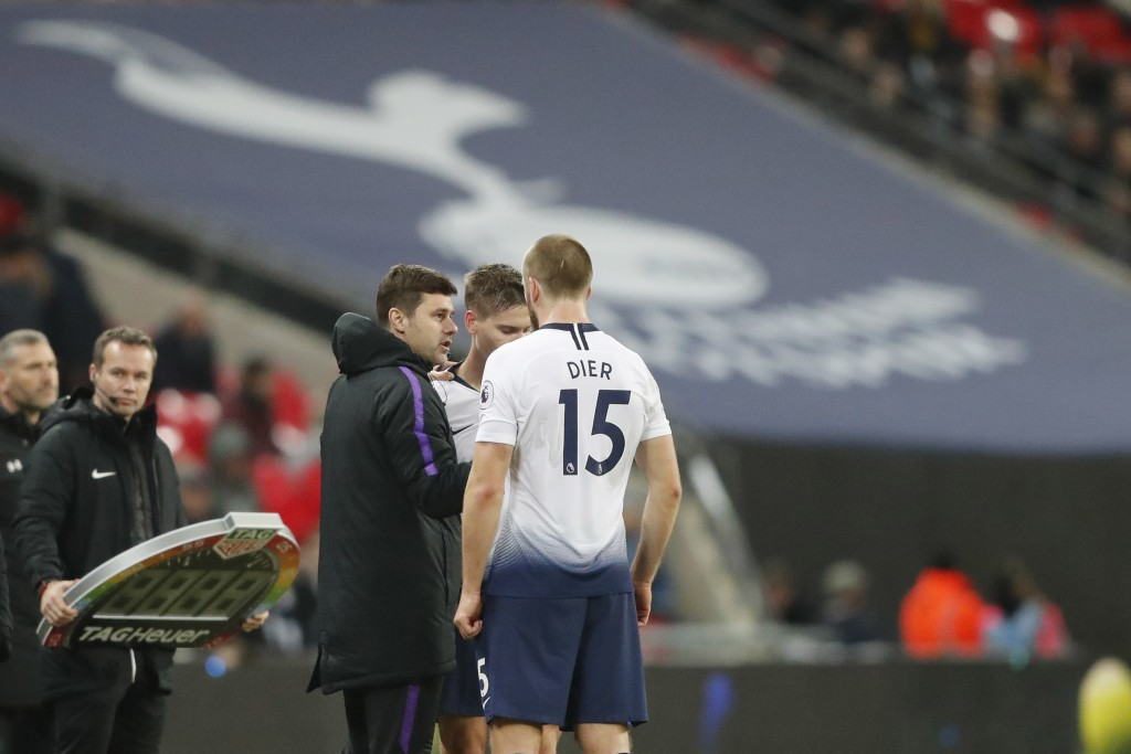 Tottenham manager Mauricio Pochettino, center, gives instructions from the side line during the English Premier League soccer match between Tottenham