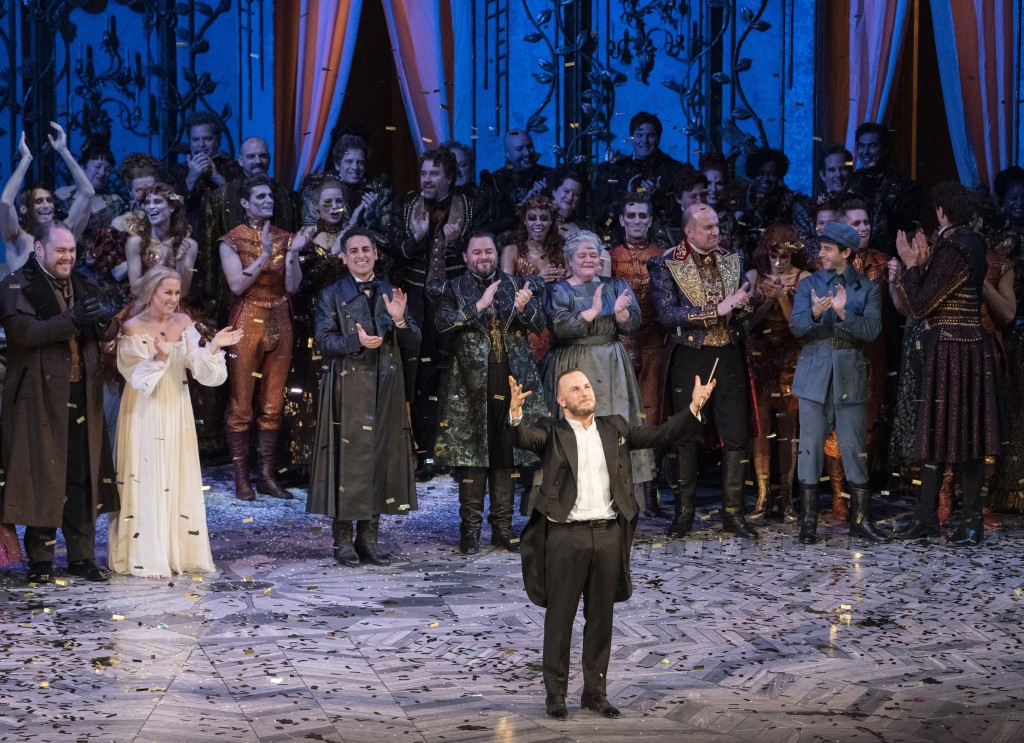 In this Dec. 4, 2018 photo released by the Metropolitan Opera, conductor Yannick Nézet-Séguin acknowledges the crowd at a curtain call following the n