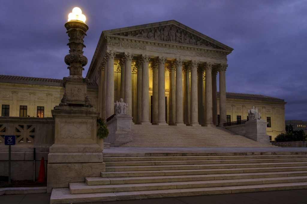 FILE - In this Oct. 5, 2018, file photo, the U. S. Supreme Court building stands quietly before dawn in Washington. The Constitution says you can't be