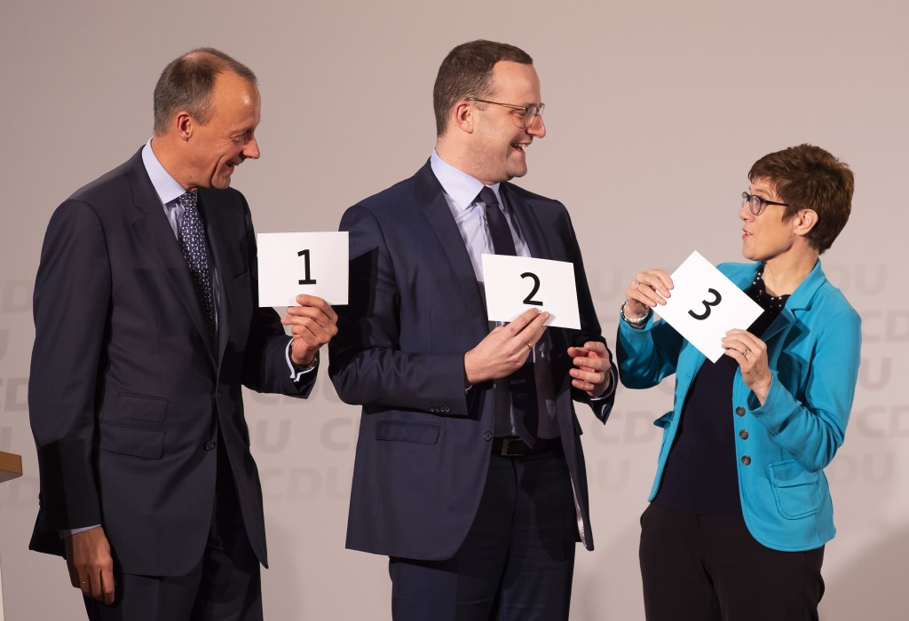 FILE - In this Wednesday, Nov. 21, 2018 file photo Friedrich Merz, former CDU faction leader, left, Germany's Health Minister Jens Spahn, center, and