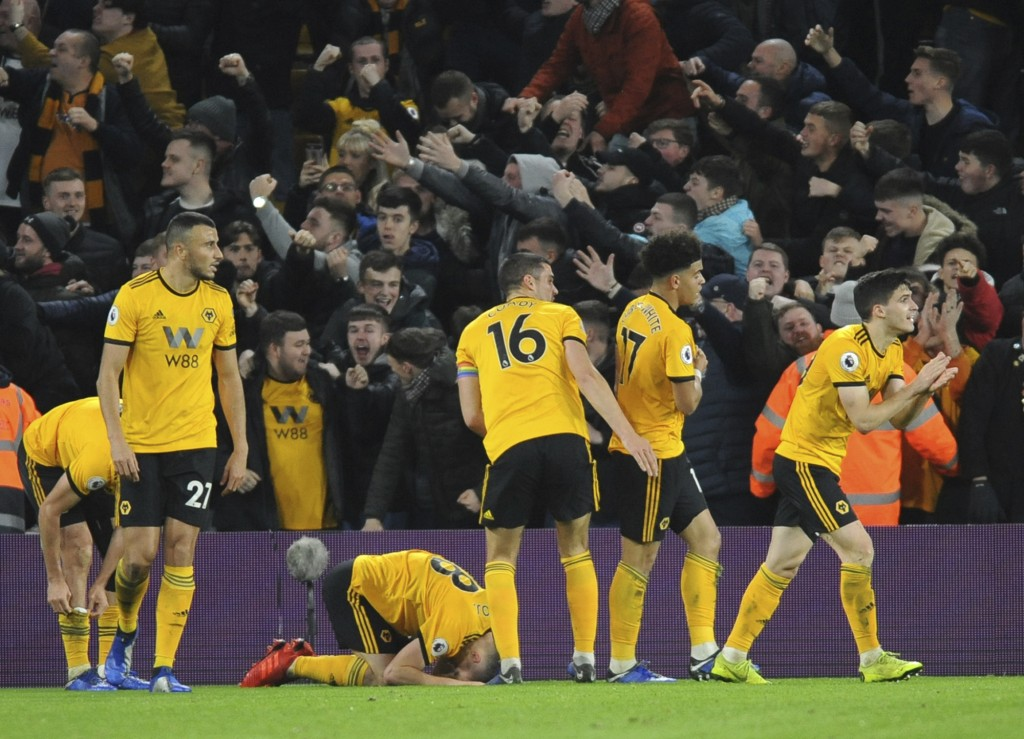 Wolverhampton Wanderers players celebrate after Diogo Jota scored his side's second goal during the English Premier League soccer match between Wolver