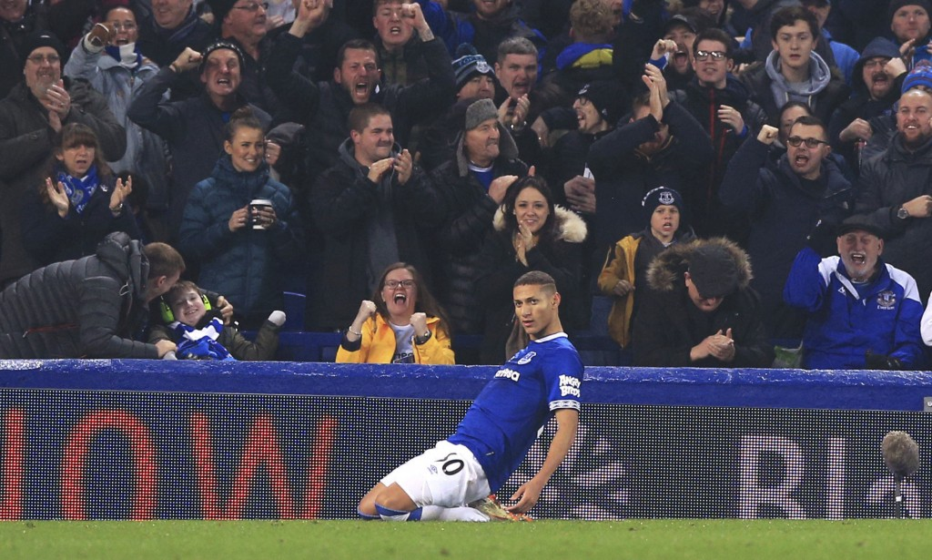 Everton's Richarlison celebrates scoring his side's first goal of the game against Newcastle United during their English Premier League soccer match a