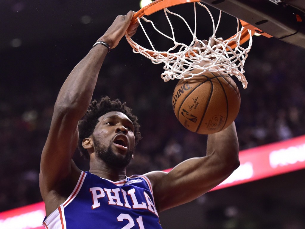 Philadelphia 76ers center Joel Embiid (21) dunks against the Toronto Raptors during second half NBA basketball action in Toronto on Wednesday, Dec. 5,