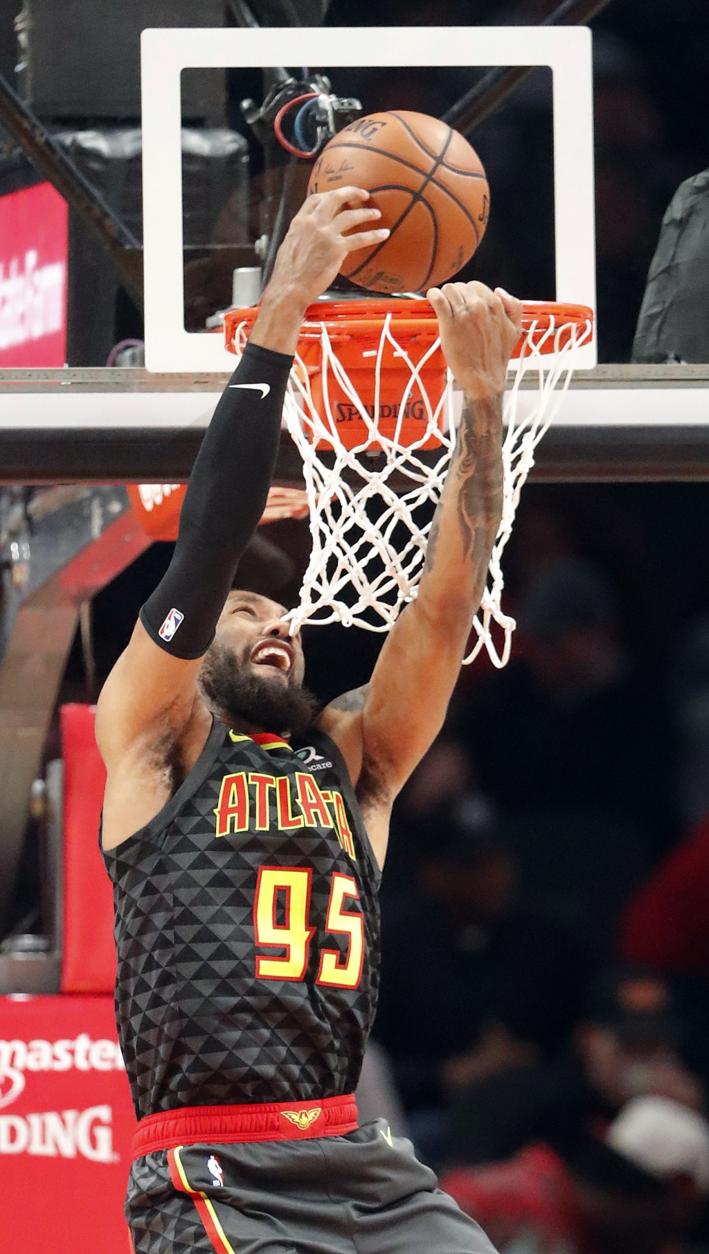 Atlanta Hawks forward DeAndre' Bembry (95) misses a dunk during the second half of an NBA basketball game against the Washington Wizards Wednesday, De