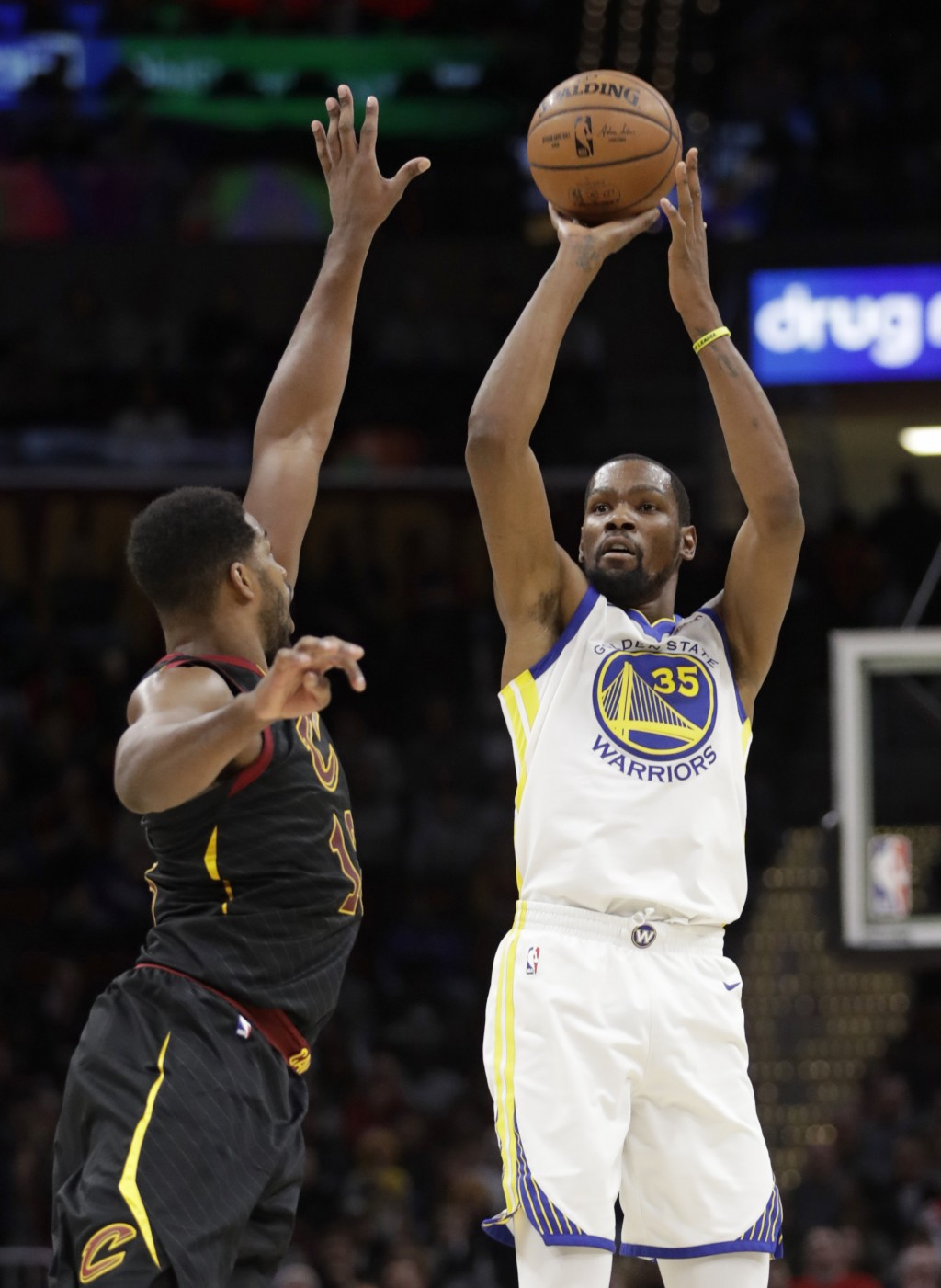 Golden State Warriors' Kevin Durant (35) shoots over Cleveland Cavaliers' Tristan Thompson (13) in the second half of an NBA basketball game, Wednesda