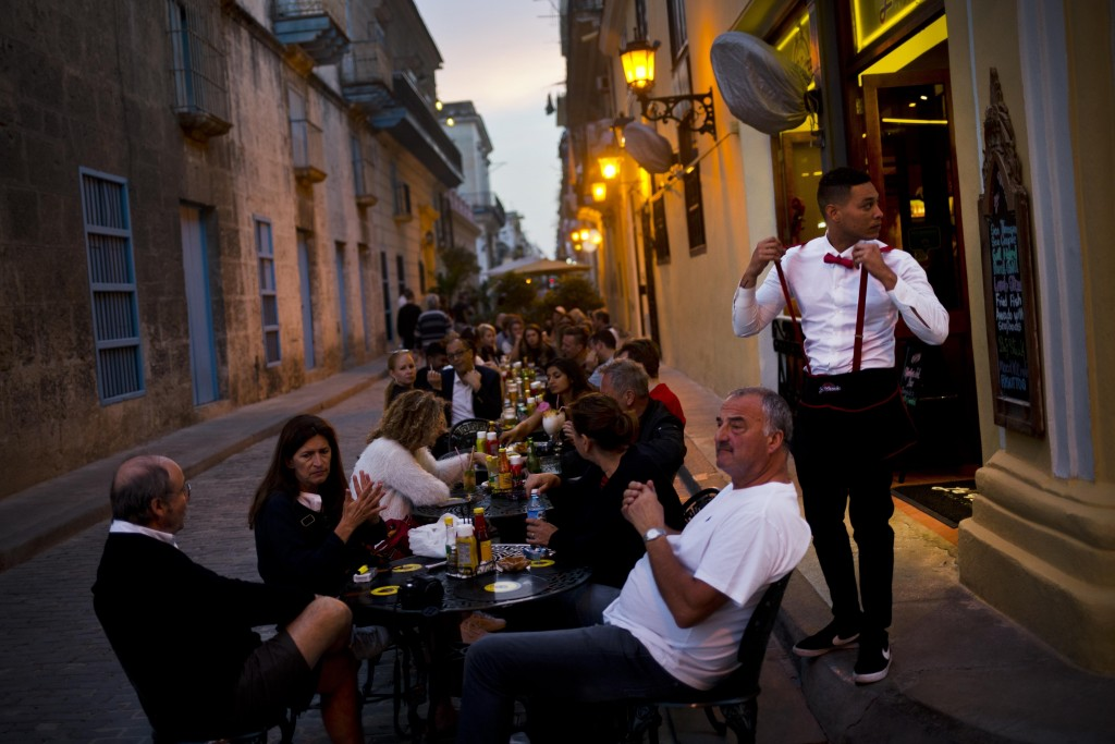 FILE - In this Jan. 31, 2018 file photo, patrons fill the outdoor seating area of a private restaurant in Havana, Cuba. Cuba's government modified in