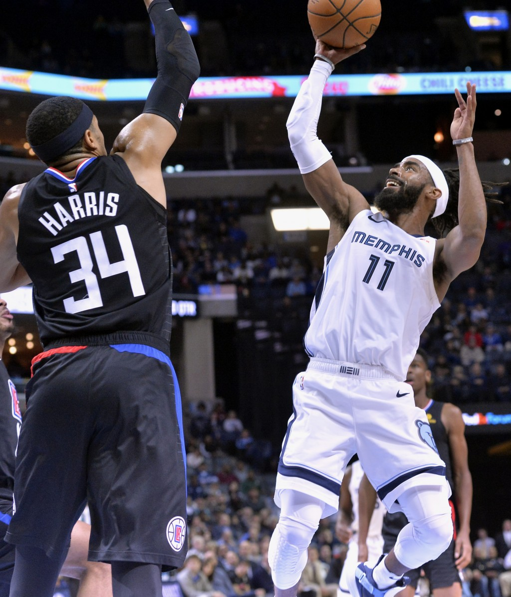 Memphis Grizzlies guard Mike Conley (11) shoots against Los Angeles Clippers forward Tobias Harris (34) in the second half of an NBA basketball game W