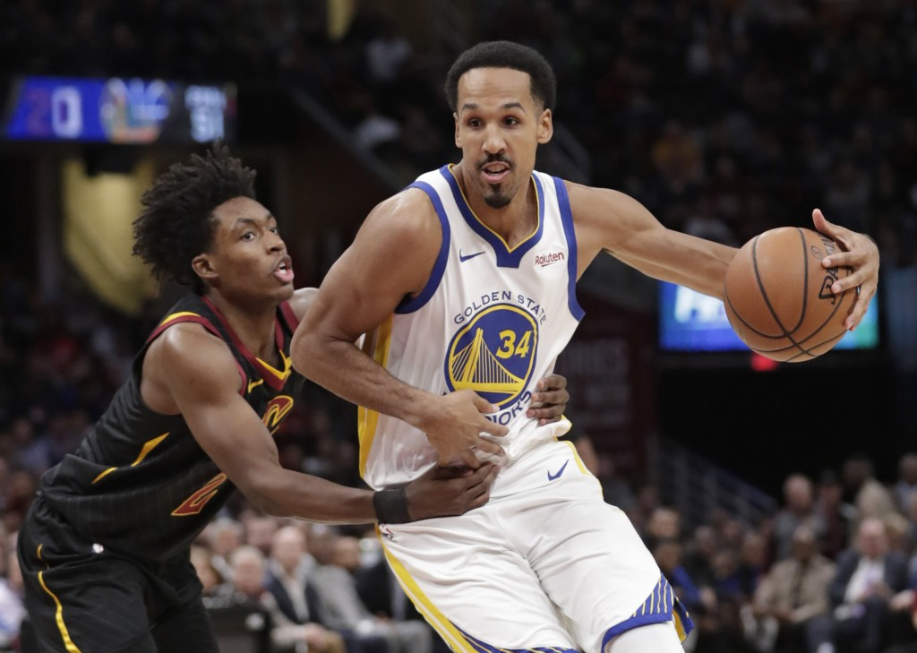 Golden State Warriors' Shaun Livingston (34) drives past Cleveland Cavaliers' Collin Sexton (2) in the second half of an NBA basketball game, Wednesda
