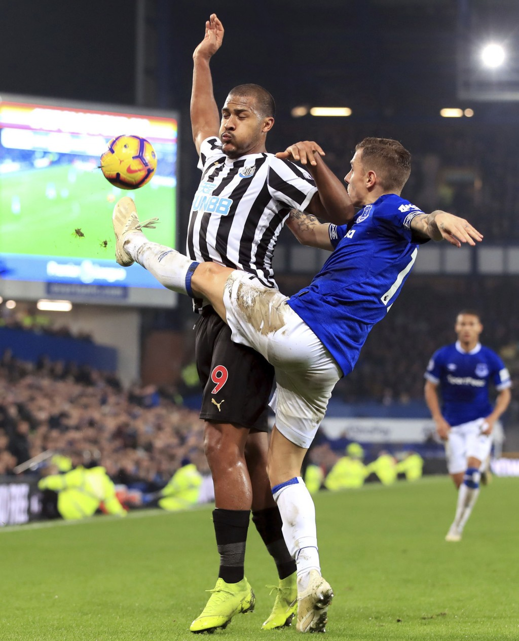 Newcastle United's Salomon Rondon, left, and Everton's Lucas Digne in action during their English Premier League soccer match at Goodison Park in Live