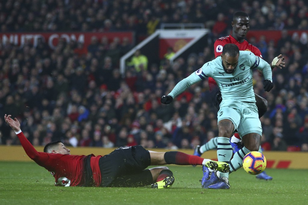 Arsenal's Alexandre Lacazette, right, scores his side's second goal during the English Premier League soccer match between Manchester United and Arsen