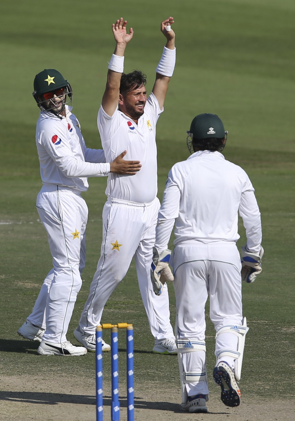 Pakistan's Yasir Shah celebrates dismissal of New Zealand's Will Sumerville in their test match in Abu Dhabi, United Arab Emirates, Thursday, Dec. 6,