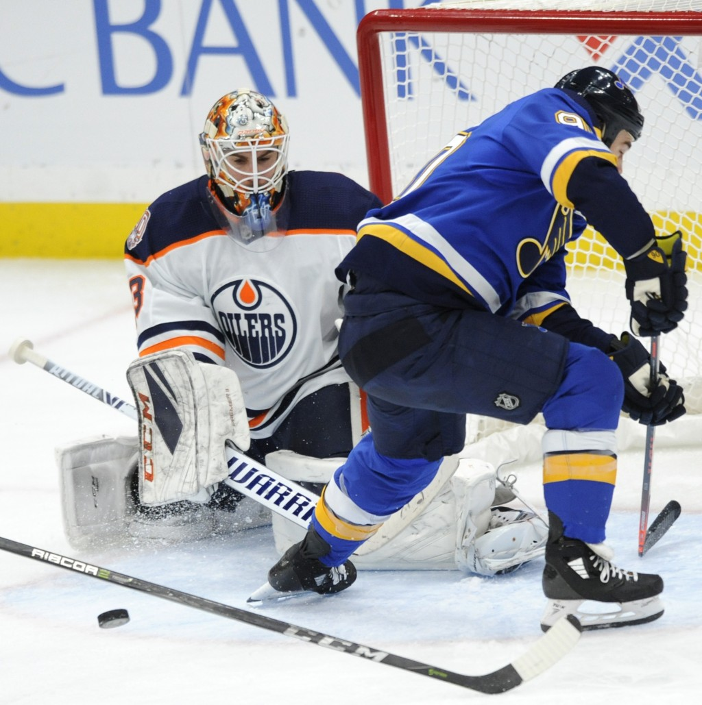 Edmonton Oilers goalie Cam Talbot (33) blocks a shot by St. Louis Blues' Ryan O'Reilly (90) during the second period of an NHL hockey game, Wednesday,