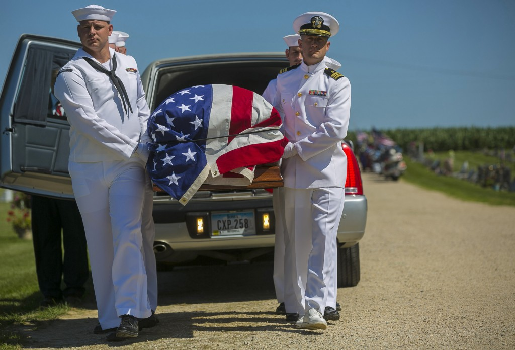FILE - In this July 7, 2018 file photo, U.S. Navy sailors remove the casket with the remains of Seaman First Class Leon Arickx from a hearse at Sacred